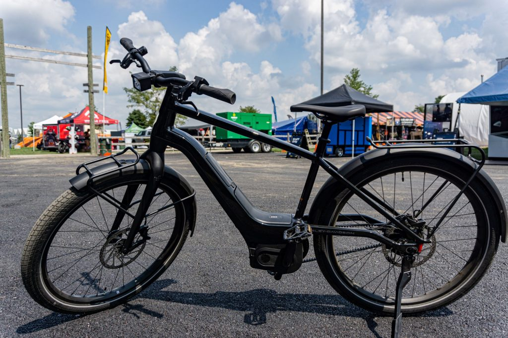 The side view of a black Serial 1 RUSH/CTY SPEED ebike in a parking lot
