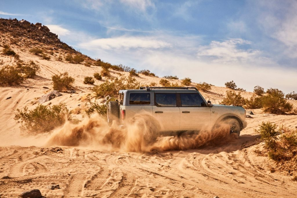 Silver 2021 Ford Bronco driving on sandy terrain