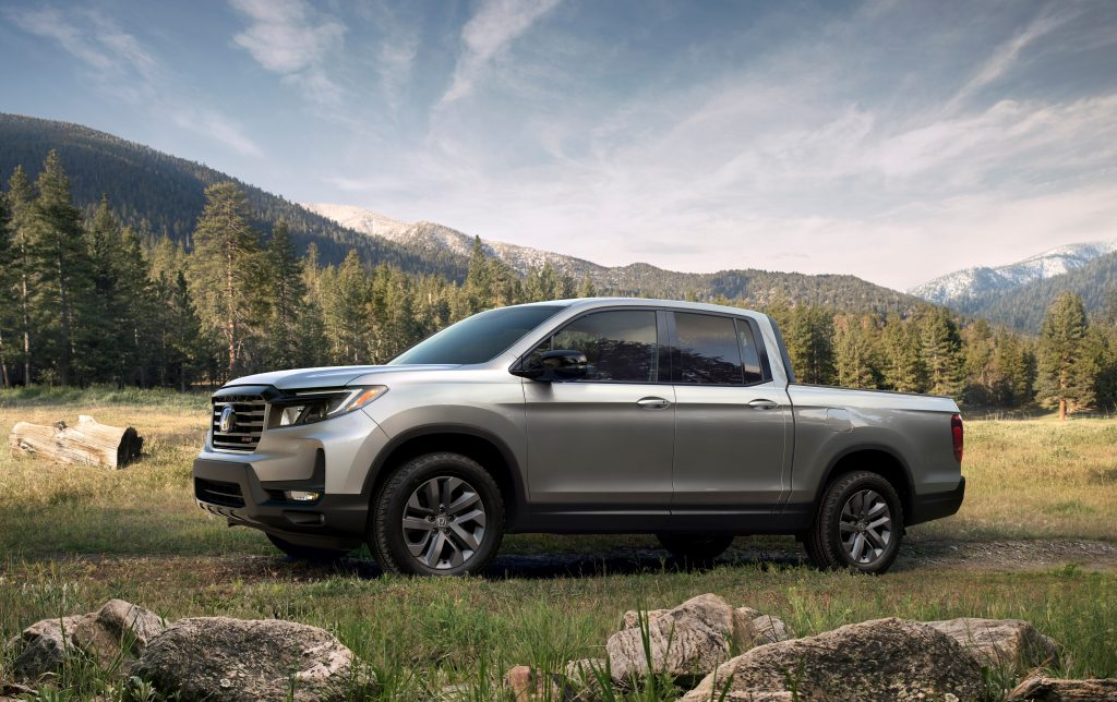 Silver 2021 Honda Ridgeline with mountains in the background