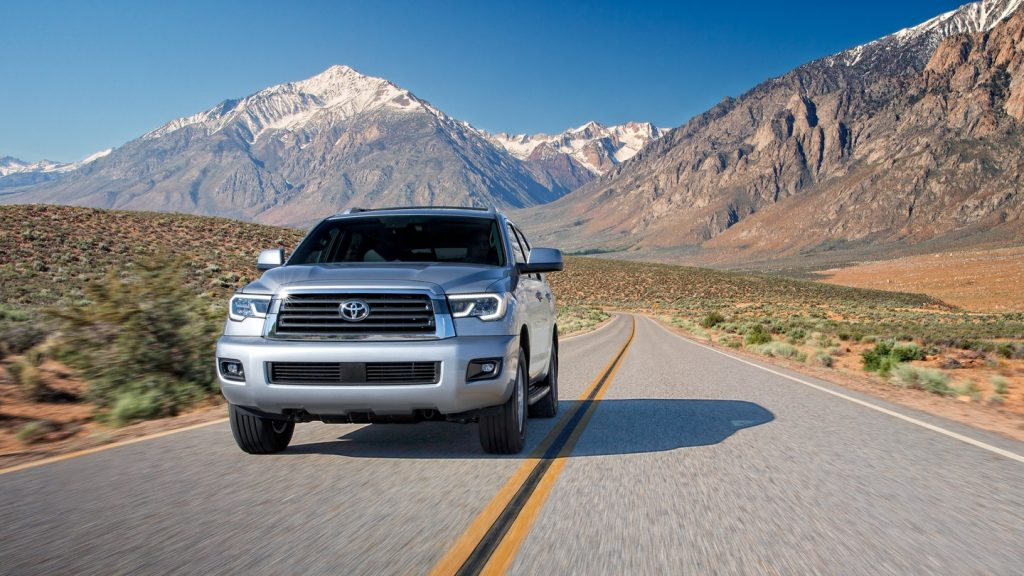 Silver 2021 Toyota Sequoia with mountains in the background