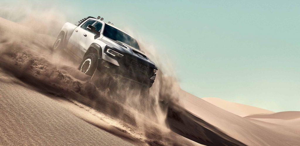 Silver 2022 Ram 1500 TRX driving down a sand dune
