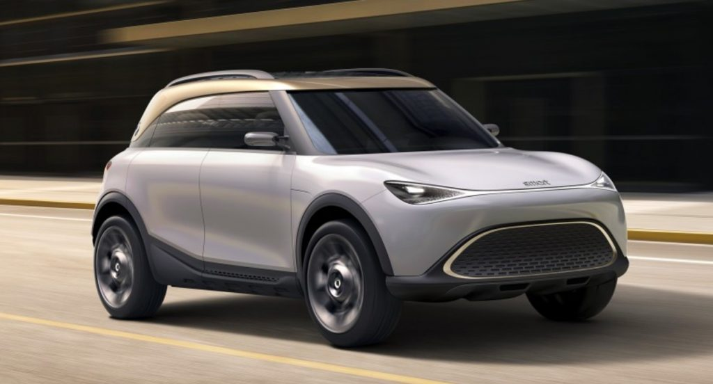 A silver Smart Concept #1 electric crossover vehicle driving on the road.