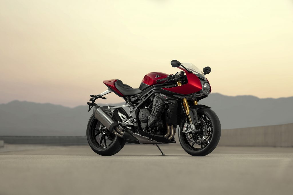 A red-and-black 2022 Triumph Speed Triple 1200 RR on a desert racetrack