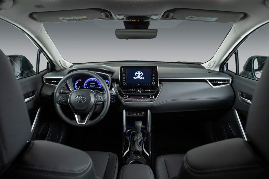 Steering wheel, gauges, and touchscreen in 2022 Toyota Corolla Cross