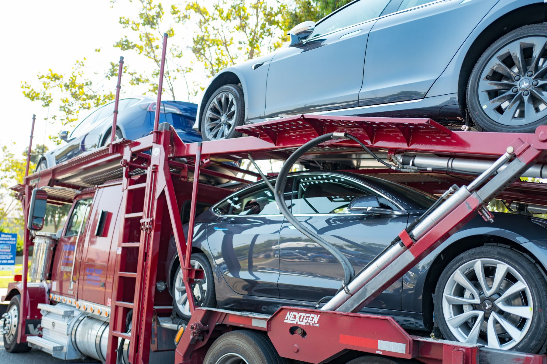 A Tesla delivery truck filled with Tesla Model 3 vehicles