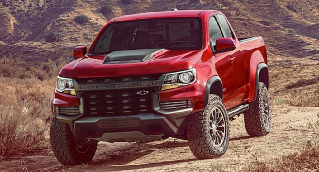 A red 2021 Chevy Colorado ZR2 off-road truck is parked in nature.