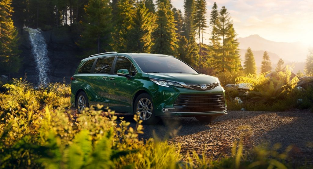 A green 2022 Toyota Sienna minivan is parked in nature.