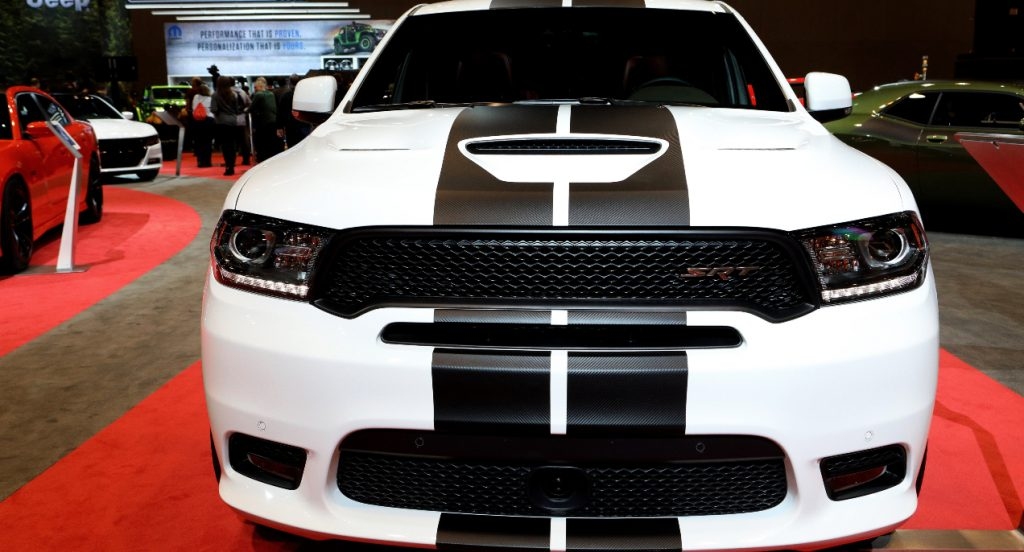 A white Dodge Durango SRT with black racing stripes is on display at the 110th Annual Chicago Auto Show at McCormick Place in Chicago, Illinois on February 9, 2018.