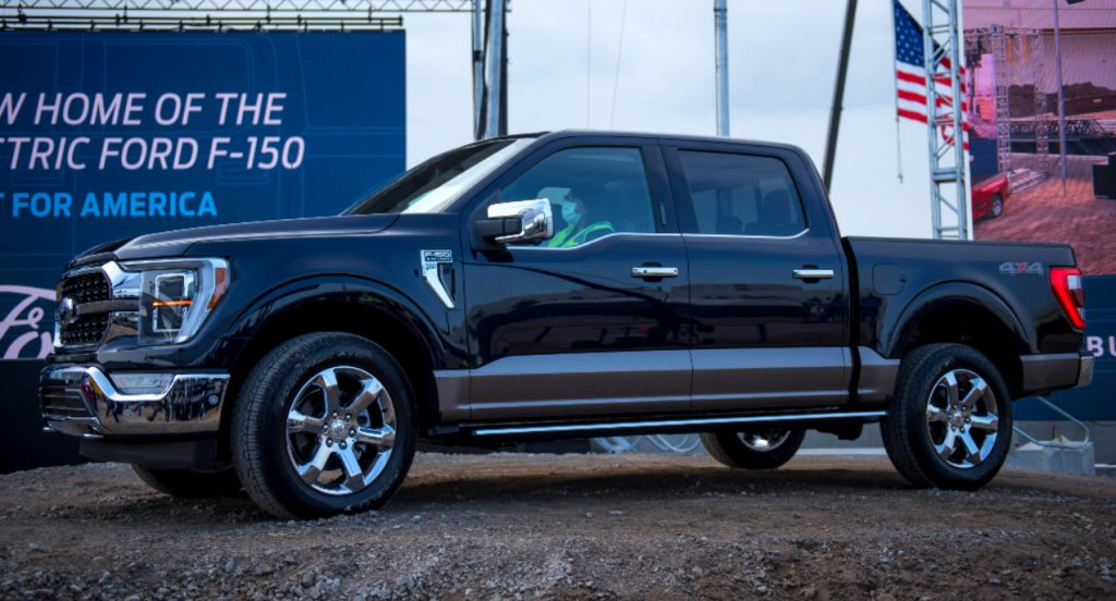 A black Ford F-150 4x4 is parked.