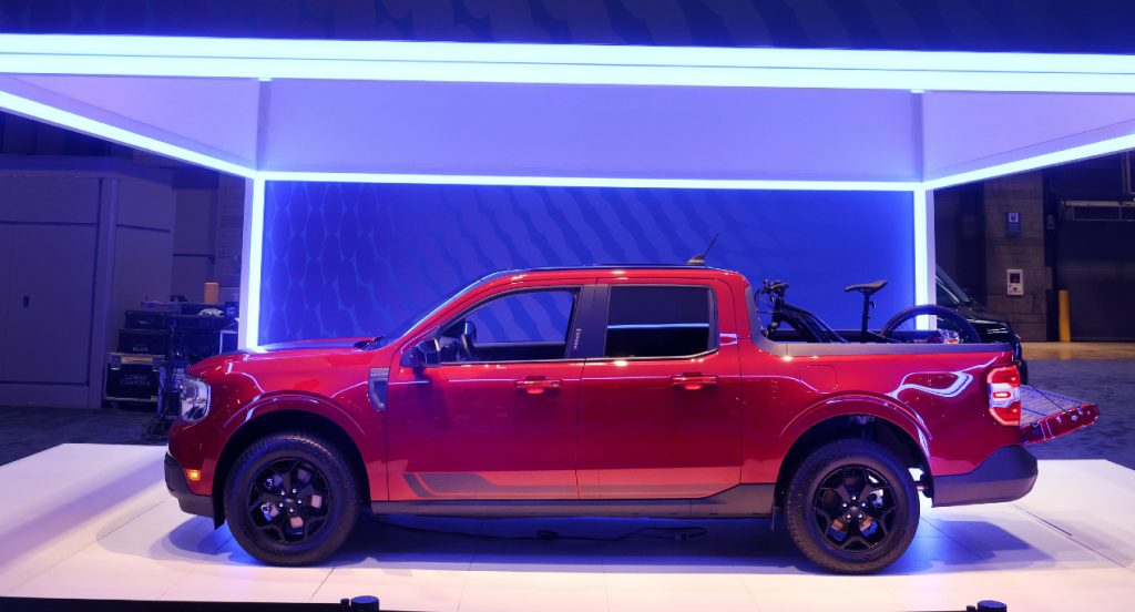 A red new Ford Maverick truck is introduced to the media at the Chicago Auto Show on July 14, 2021 in Chicago, Illinois.