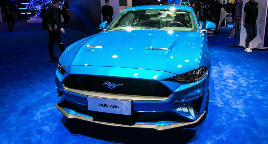 A blue Ford Mustang Mach-E SUV.