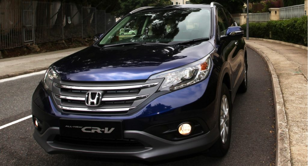 A navy blue Honda CR-V is parked on the road.