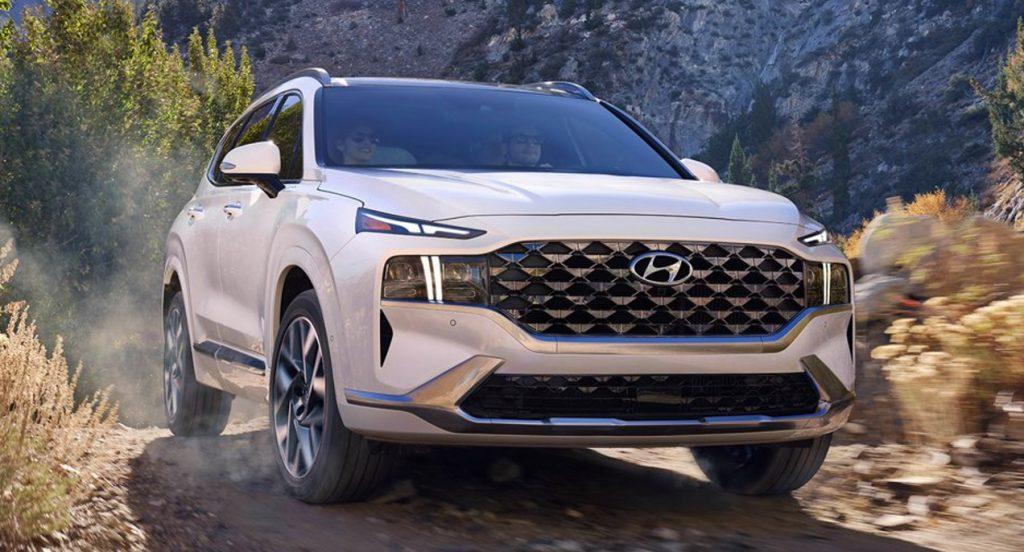 A white Hyundai Santa Fe SUV is off-roading.