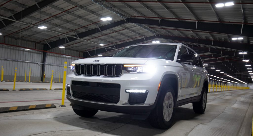A white Jeep Grand Cherokee drives on the BSR (Buzz, Squeak and Rattle) indoor test track at the Stellantis Detroit Assembly Complex-Mack on June 10, 2021 in Detroit, Michigan.