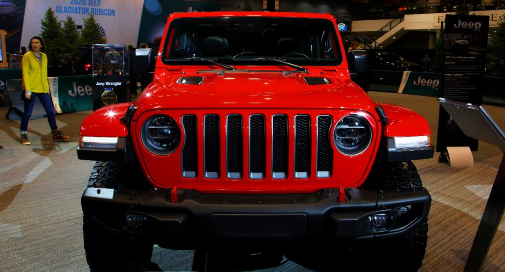 A red Jeep Wrangler is displayed.