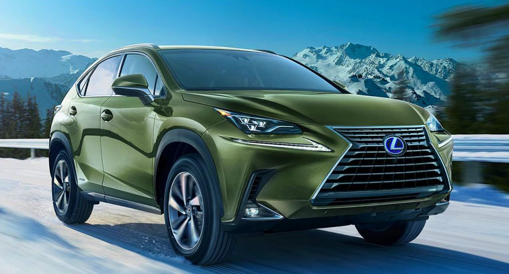 A green Lexus NX450h parked outside
