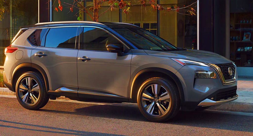 A gray Nissan Rogue compact SUV is parked on the street.