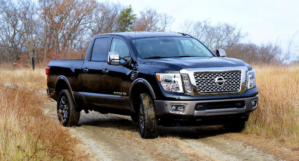 A black Nissan Titan pickup truck.