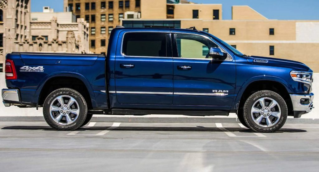 A blue Ram 1500 pickup truck is parked in a parking lot.