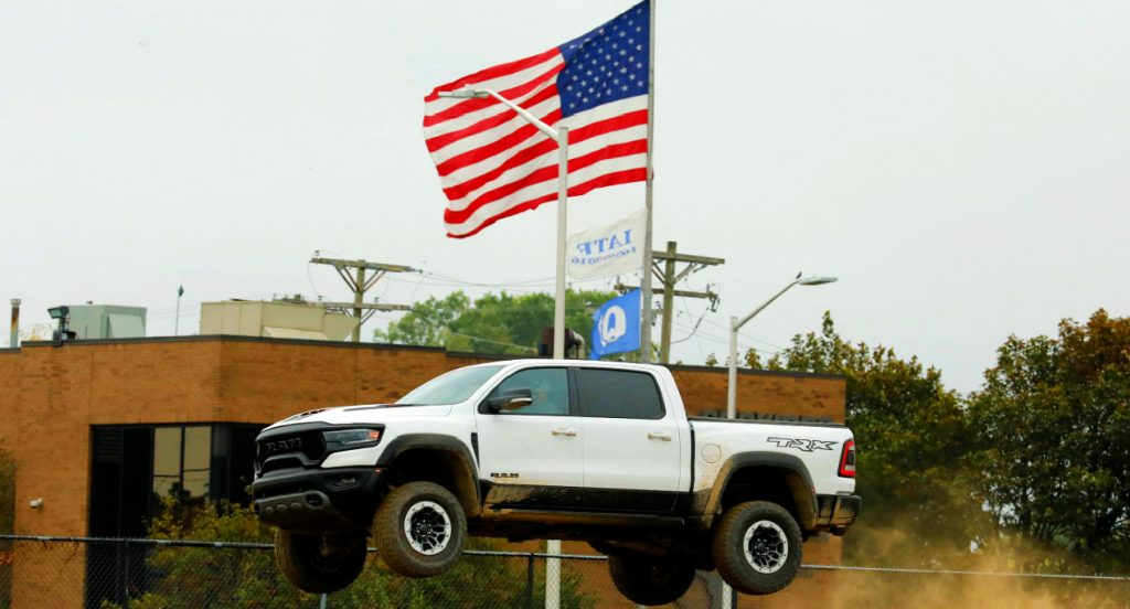 A white Ram 1500 TRX pickup truck on a test track during the Motor Bella event in Pontiac, Michigan on September 21, 2021.