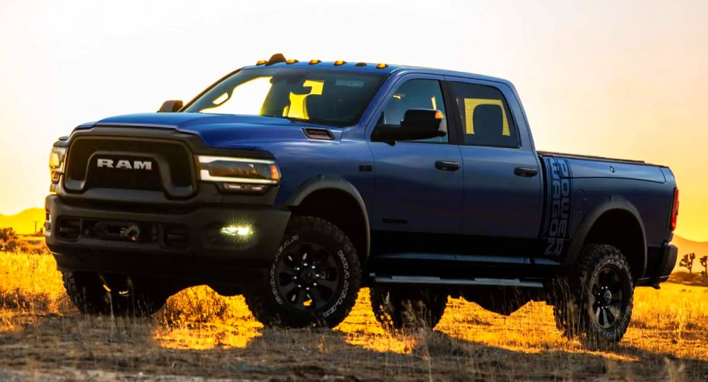 A Ram 2500 Power Wagon parked in a field during a sunset