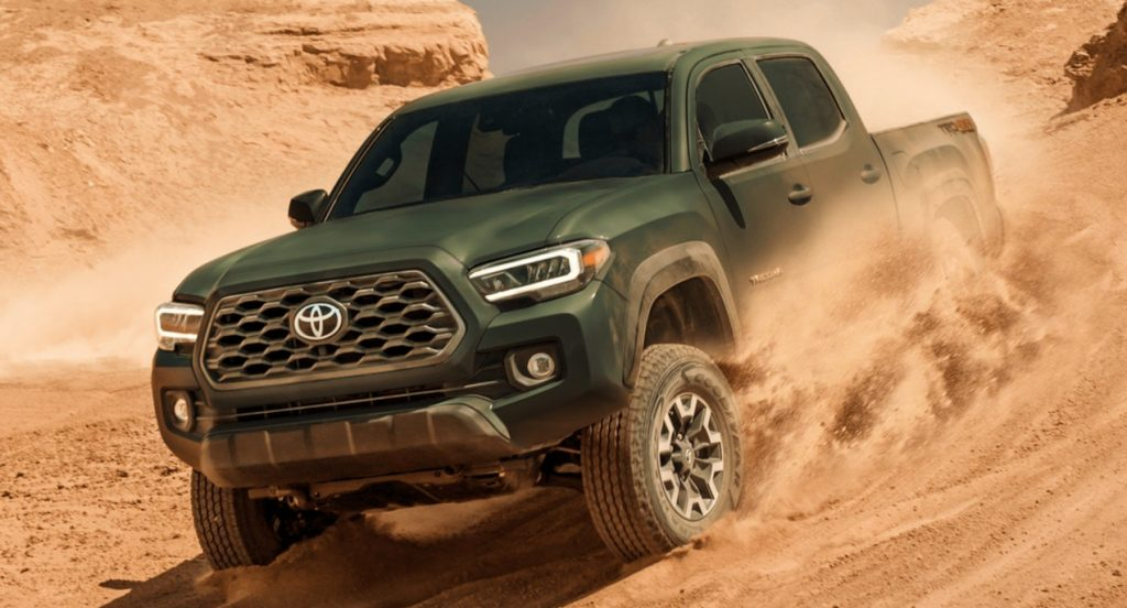 Green 2021 toyota tacoma driving in the desert