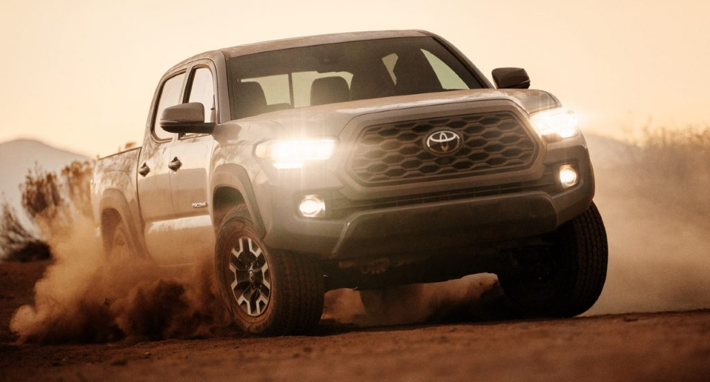 A gray Toyota Tacoma truck is off-roading.