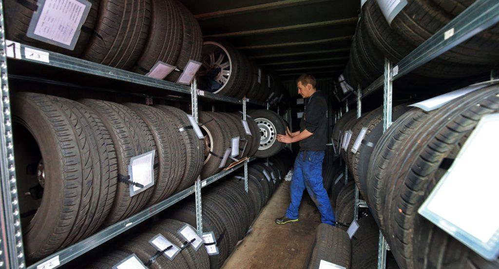 A man is inside a tire shop.