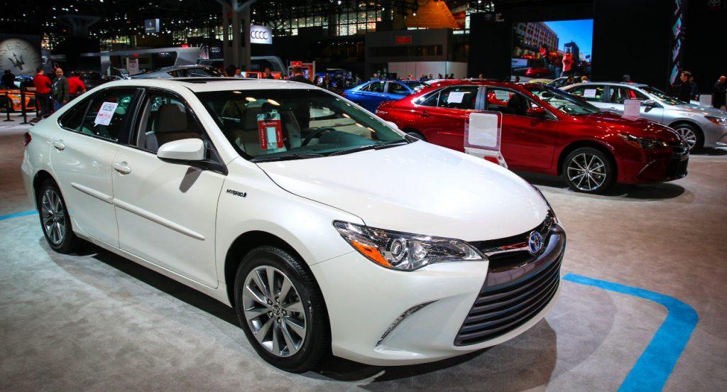 A white Toyota Camry Hybrid.