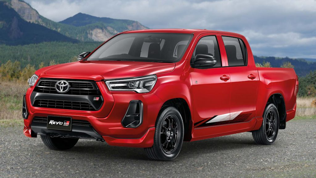The Toyota Hilux Revo GR Sport in front of mountains