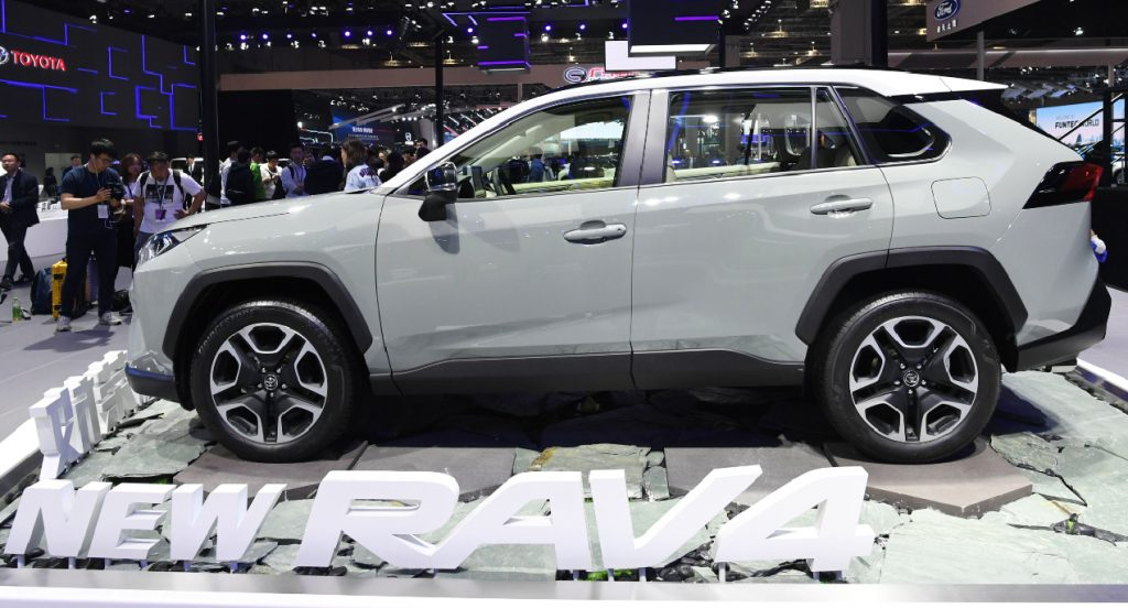 A gray Toyota Rav4's side profile is on display at an autoshow.