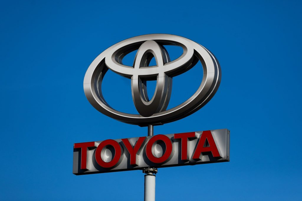 Toyota Sign with the logo on top and Toyota written in red.