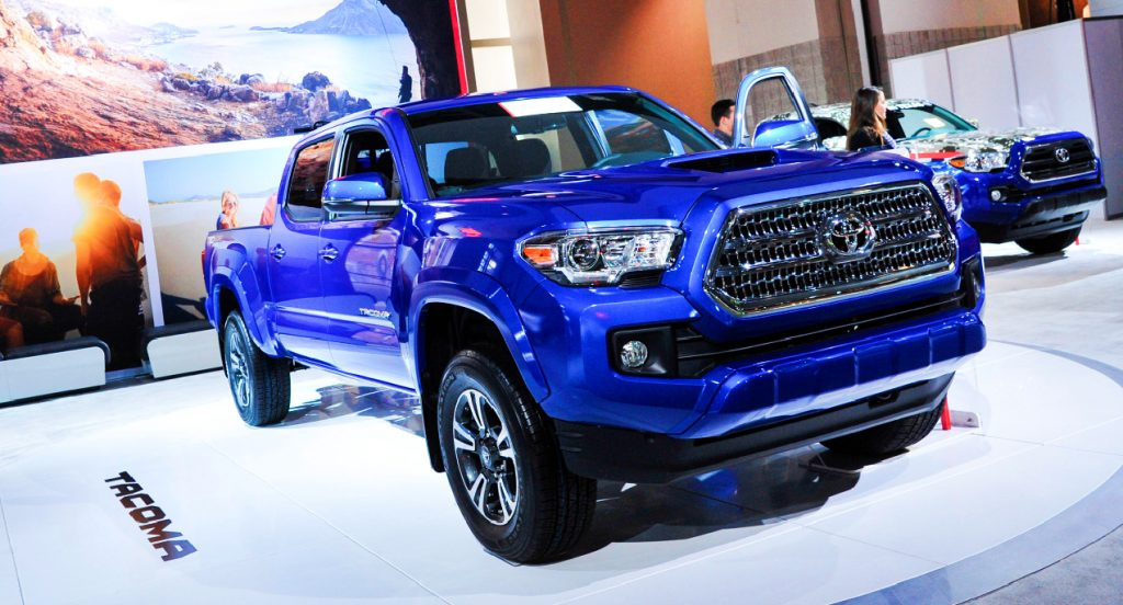 A blue Toyota Tacoma pickup truck is on display.