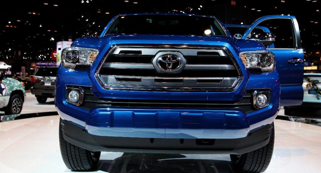 A blue Toyota Tacoma pickup truck.