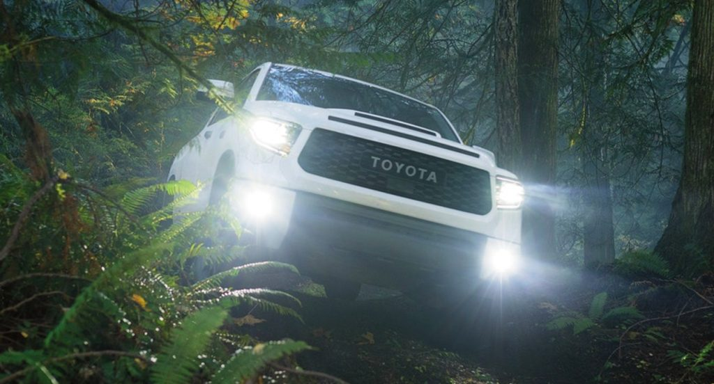 A 2021 Toyota Tundra off-roading in the woods