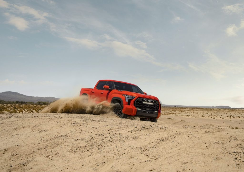 This is a promo photo of a 2022 Toyota Tundra TRD Pro offroading. This high-speed offroad truck is a cost-effective Ford Raptor
