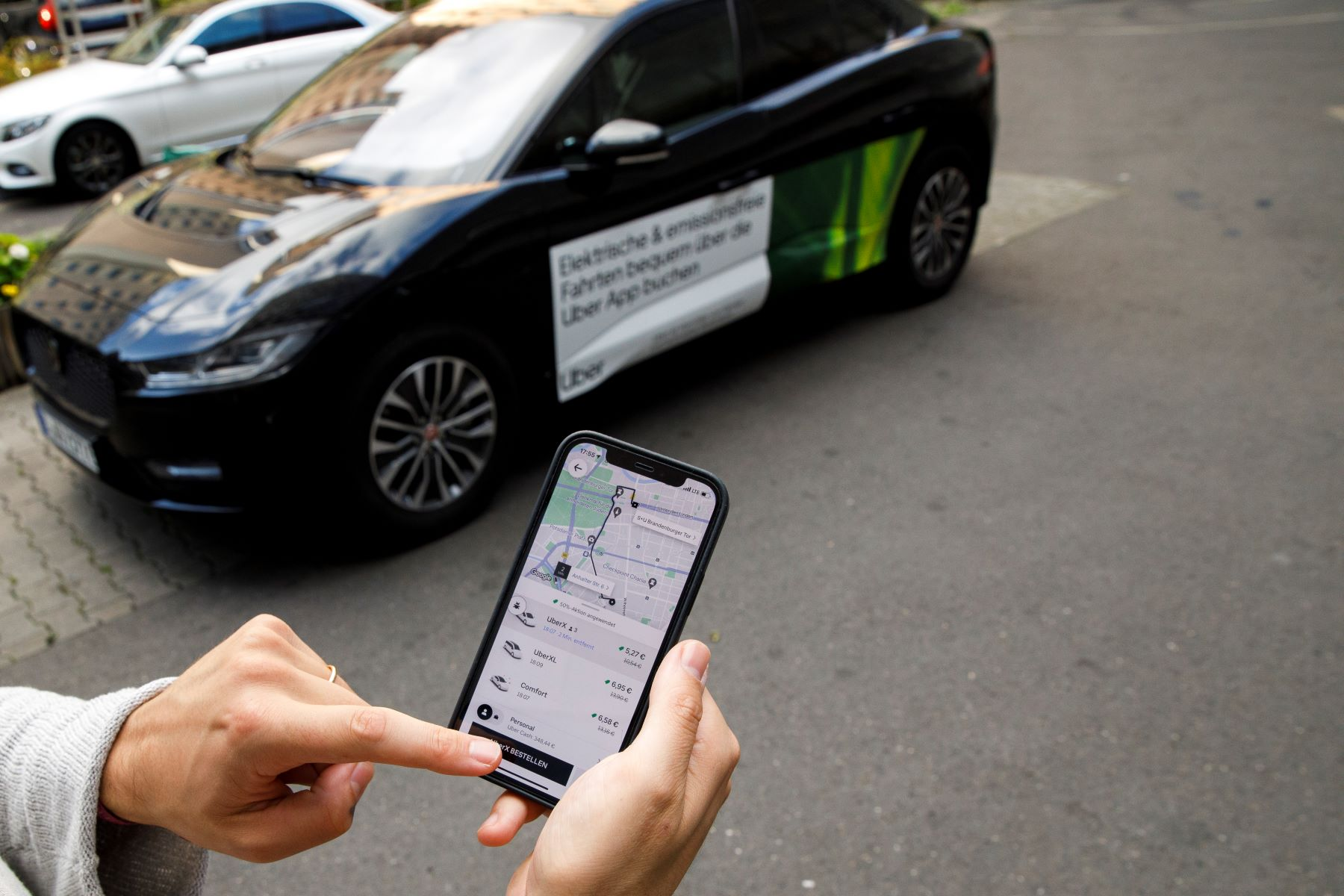 A customer ordering an Uber on their phone in Berlin, Germany