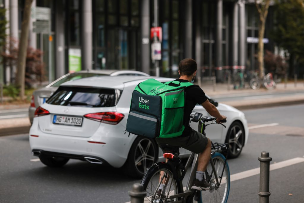 An Uber Eats delivery person rides a bicycle on August 20, 2021 in Frankfurt, Germany.