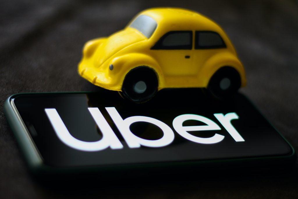 Uber logo displayed on a phone screen is seen in this illustration