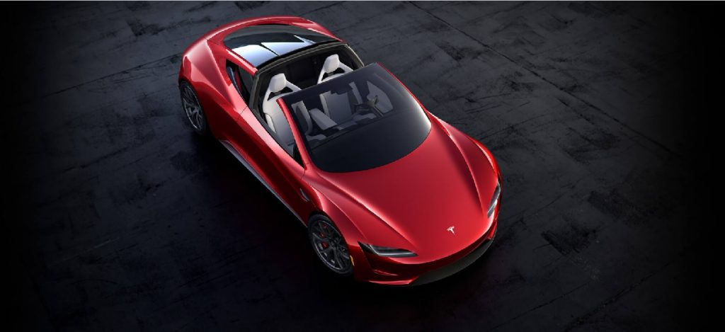 A red Tesla Roadster from above.