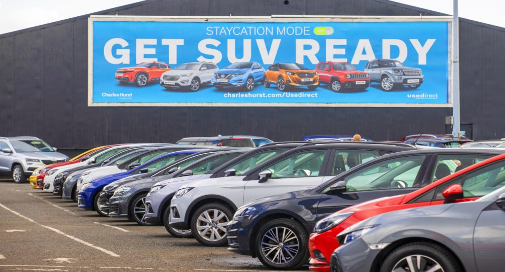 Potential customers walk around Charles Hurst Usedirect used car dealership on Boucher Road in Belfast as restrictions in Northern Ireland ease allowing new and used cars sales.