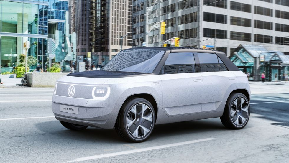 A grey Volkswagen ID.Life concept electric mini-suv parked in a city street