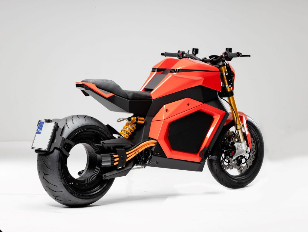 The rear 3/4 view of an orange-and-black Verge TS electric motorcycle