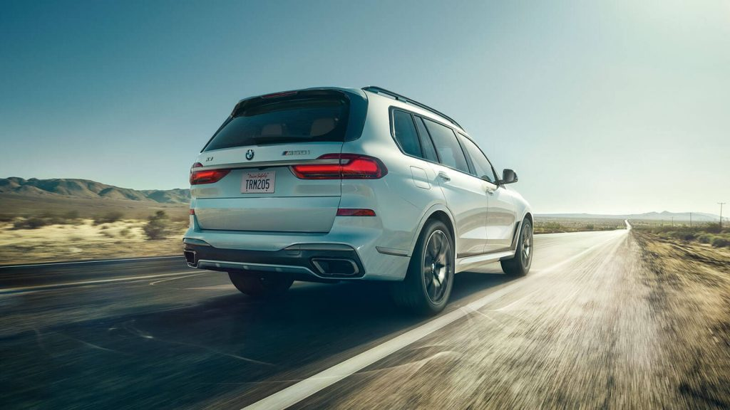 White 2022 BMW X7 driving on a desert highway