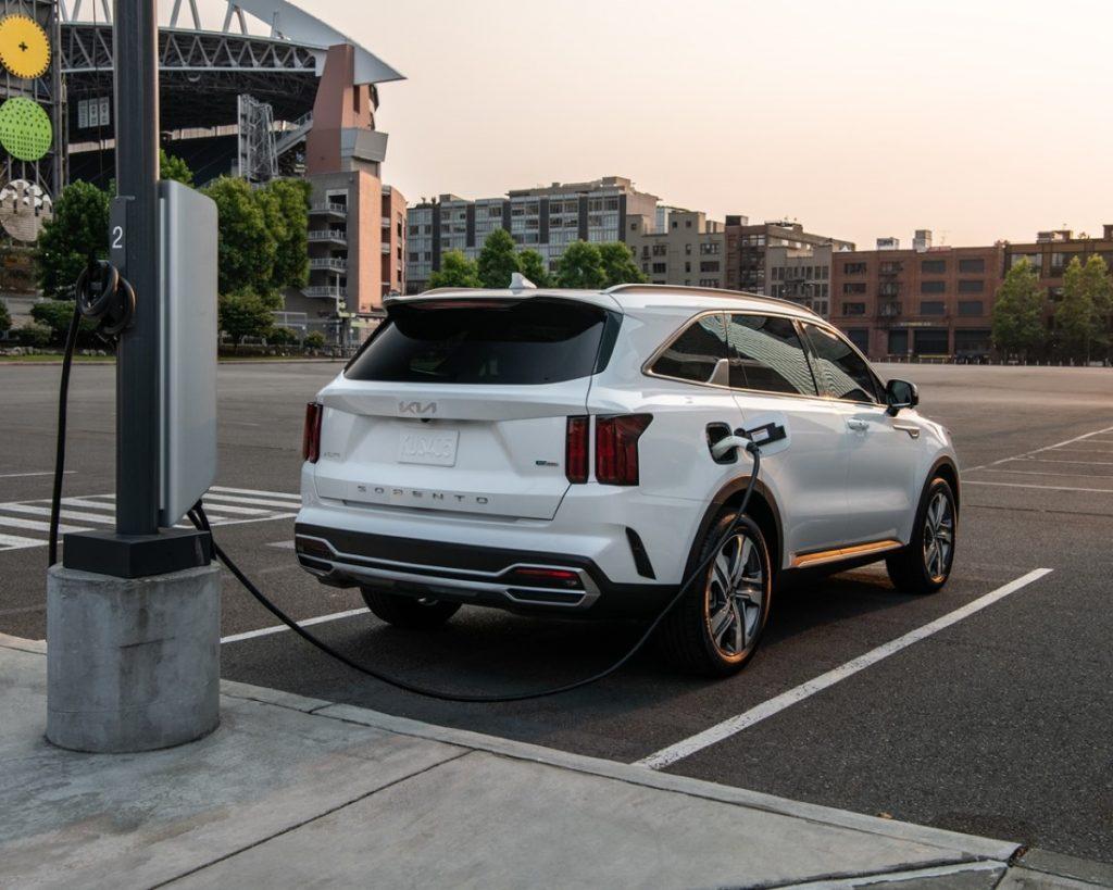 White 2022 Kia Sorento Plug-In Hybrid charging at a charging station