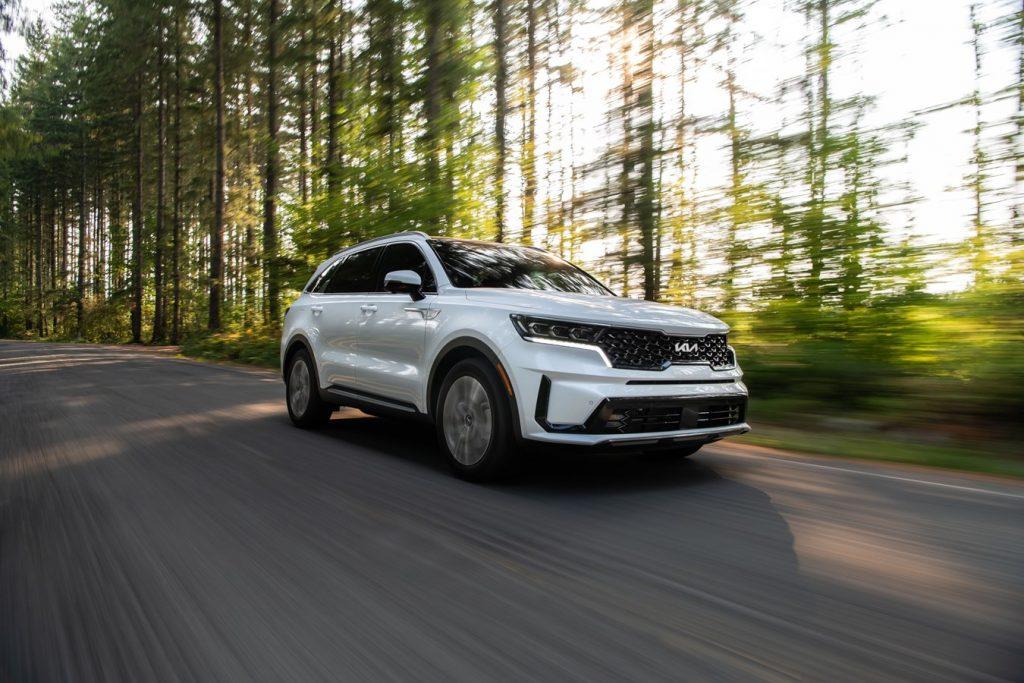 White 2022 Kia Sorento Plug-In Hybrid driving through a forest