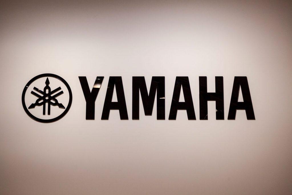 Black Yamaha logo against a cream background.