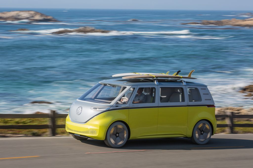 Yellow and white Volkswagen ID. Buzz concept van driving on a coastal road