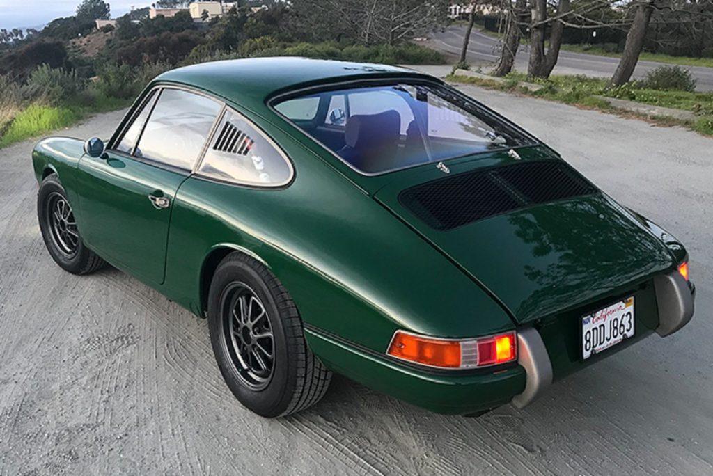 The rear 3/4 view of Zelectric's green 'Tesla Porsche' 1968 Porsche 912