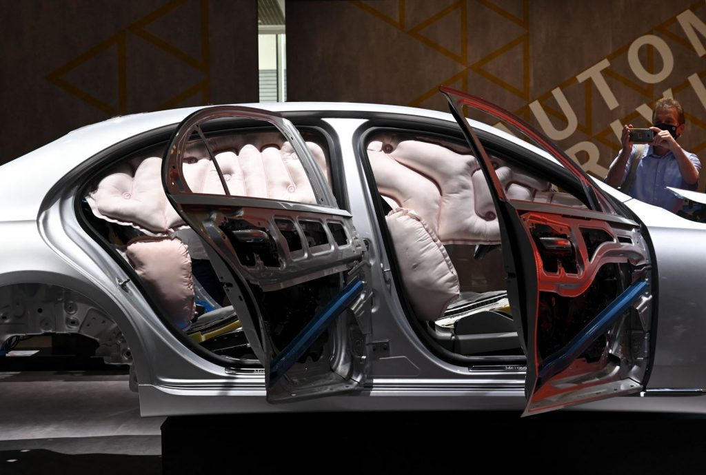 An airbag functionality safety test done on a Mercedes-Benz vehicle frame